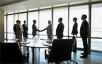 Business people shaking hands in conference room Stock Photo - Premium Royalty-Freenull, Code: 635-06045119