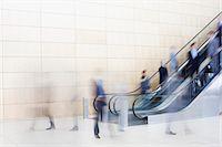 Business people on escalators Stock Photo - Premium Royalty-Freenull, Code: 635-06045128