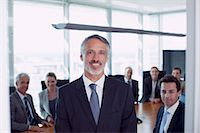 Portrait of smiling businessman and co-workers in conference room Stock Photo - Premium Royalty-Freenull, Code: 635-06045132