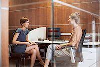 Businesswomen talking in office Stock Photo - Premium Royalty-Freenull, Code: 635-06045174