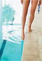 swimming pool water - Woman dipping toe in swimming pool Stock Photo - Premium Royalty-Freenull, Code: 635-06045249