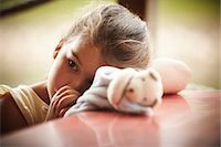sucking - Close up of girl with stuffed animal sucking thumb Stock Photo - Premium Royalty-Freenull, Code: 635-06045572