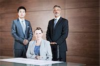Portrait of confident business people in conference room Stock Photo - Premium Royalty-Freenull, Code: 635-06045583