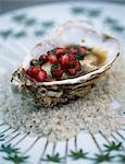 Hot oyster with hazelnut butter and pomegranate seeds and coriander Stock Photo - Premium Rights-Managed, Artist: Photocuisine, Code: 825-06045877