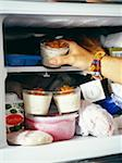Person taking food out of a freezer Stock Photo - Premium Rights-Managed, Artist: Photocuisine, Code: 825-06045914