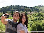 Italy, Florence, Young couple photographing themselves in rural area Stock Photo - Premium Royalty-Free, Artist: Cultura RM, Code: 640-06049819