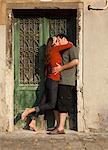 Italy, Venice, Couple kissing by wooden door in old town Stock Photo - Premium Royalty-Free, Artist: Robert Harding Images, Code: 640-06049846