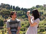 Italy, Florence, Young woman photographing young man in rural area Stock Photo - Premium Royalty-Free, Artist: GreatStock, Code: 640-06049936