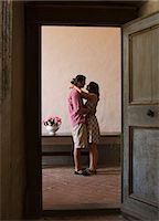 Italy, Tuscany, Young couple kissing in old house Stock Photo - Premium Royalty-Freenull, Code: 640-06050284