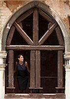 Italy, Venice, Woman standing in arcade Stock Photo - Premium Royalty-Freenull, Code: 640-06050329