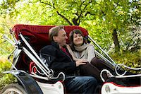 USA, New York City, Manhattan, Central Park, Mature couple in carriage in Central Park Stock Photo - Premium Royalty-Freenull, Code: 640-06050697