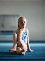 preteen girls stretching - USA, Utah, Orem, Girl (10-11) stretching in gym Stock Photo - Premium Royalty-Freenull, Code: 640-06050725