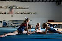 preteen girls gymnastics - USA, Utah, Orem Girls (8-11) stretching in gym Stock Photo - Premium Royalty-Freenull, Code: 640-06050729