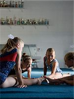 preteen girls stretching - USA, Utah, Orem, girls (8-11) exercising in gym Stock Photo - Premium Royalty-Freenull, Code: 640-06050730