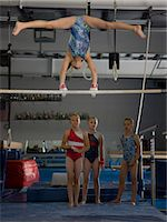 USA, Utah, Orem, girls (10-11) in gym watching friend exercising on pole Stock Photo - Premium Royalty-Freenull, Code: 640-06050734