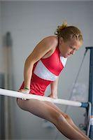 preteen girls stretching - USA, Utah, Orem, girl (10-11) exercising on pole in gym Stock Photo - Premium Royalty-Freenull, Code: 640-06050735