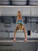 preteen girls stretching - USA, Utah, Orem, girl (10-11) exercising on pole in gym Stock Photo - Premium Royalty-Freenull, Code: 640-06050736