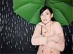 woman in a chalkboard rainstorm Stock Photo - Premium Royalty-Free, Artist: Cultura RM, Code: 640-06051013
