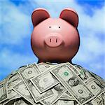 piggy bank on a pile of dollars Stock Photo - Premium Royalty-Free, Artist: iRepublic, Code: 640-06051130