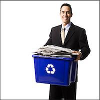 businessperson holding a recycling bin Stock Photo - Premium Royalty-Freenull, Code: 640-06051170