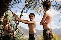 boys at a rope swing Stock Photo - Premium Royalty-Freenull, Code: 640-06051569