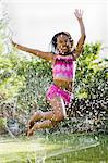 children playing in a sprinkler Stock Photo - Premium Royalty-Free, Artist: Cultura RM, Code: 640-06051627