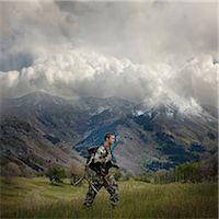 hunter walking through the wilderness with deer antlers Stock Photo - Premium Royalty-Freenull, Code: 640-06051633