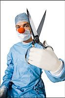 surgeon wearing a creepy clown nose and holding scissors Stock Photo - Premium Royalty-Freenull, Code: 640-06051647