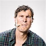 White trash man smoking Stock Photo - Premium Royalty-Free, Artist: Jose Luis Stephens, Code: 640-06051714