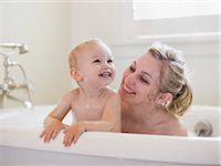 mother and baby taking a bubble bath Stock Photo - Premium Royalty-Freenull, Code: 640-06051822