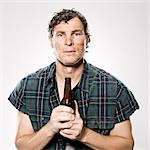 homeless man holding a beer bottle Stock Photo - Premium Royalty-Free, Artist: Siephoto, Code: 640-06052161