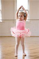 Girl (2-3) practicing ballet in studio Stock Photo - Premium Royalty-Freenull, Code: 640-06052217