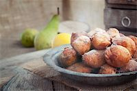 Bowl of Deep fried fritters donuts in rustic country setting Stock Photo - Royalty-Freenull, Code: 400-06062209
