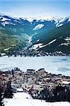 Aerial view down on Zell Am See (Austria, Alpes) town, frozen lake, ski resort and mountains in fog. Stock Photo - Royalty-Free, Artist: Dinga                         , Code: 400-06063480