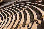 A section of the stone seating area in the Teatro Antico theater. The old Greek and Roman theatre is still used for musical or other performances. Stock Photo - Royalty-Free, Artist: searagen                      , Code: 400-06065220