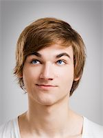Portrait of a handsome young man, over a gray background Stock Photo - Royalty-Freenull, Code: 400-06065849