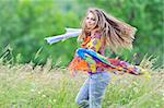 Jumping girl against summer meadow Stock Photo - Royalty-Free, Artist: jordache                      , Code: 400-06066699