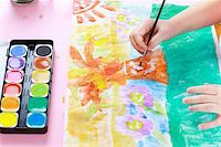 Detail of hands painting with watercolor Stock Photo - Royalty-Freenull, Code: 400-06068460