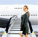 beautiful flight attendant near moving ramp in airport Stock Photo - Royalty-Free, Artist: ssuaphoto                     , Code: 400-06069222