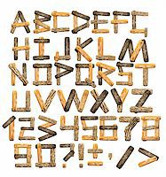 Alphabet - letters from wooden boards and bark Stock Photo - Royalty-Freenull, Code: 400-06069752