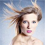 Fashion portrait of beautiful woman with streaming hair Stock Photo - Royalty-Free, Artist: stolbik84                     , Code: 400-06070547
