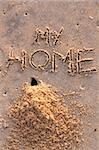 Crab hole and a pile of sand with words my home on a beach Stock Photo - Royalty-Free, Artist: smarnad                       , Code: 400-06071042