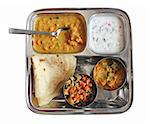 Traditional Indian bread chapati with curries, raitha and salad isolated on white Stock Photo - Royalty-Free, Artist: smarnad                       , Code: 400-06071355