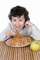 Adorable child hungry at the time of eating a over white background Stock Photo - Royalty-Freenull, Code: 400-06071463