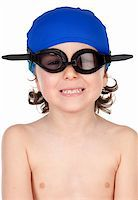 Funny boy with glasses and hat swimmer ready to learn to swim isolated on blano Stock Photo - Royalty-Freenull, Code: 400-06071464
