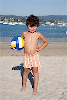 Beautiful little boy on the beach with a soccer ball Stock Photo - Royalty-Freenull, Code: 400-06071467
