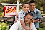 Hispanic Father and Sons in Front of a Sold Home For Sale Real Estate Sign. Stock Photo - Royalty-Free, Artist: Feverpitched                  , Code: 400-06072561