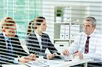 Portrait of busy people discussing new working plan at meeting in office Stock Photo - Royalty-Free, Artist: pressmaster                   , Code: 400-06074380
