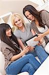 Three beautiful young women friends at home using tablet computer and laughing Stock Photo - Royalty-Free, Artist: darrenbaker                   , Code: 400-06074857