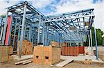 New home under construction using steel frames against a blue sky Stock Photo - Royalty-Free, Artist: LevKr                         , Code: 400-06074947